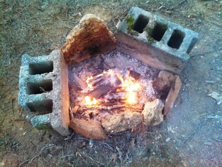 Fire pit built from property scrounged materials
